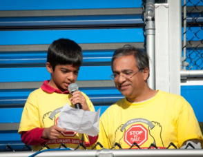 Anay reads the Pledge with Dad Sunil