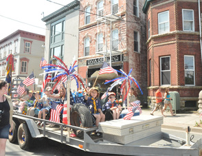 Boy Scouts wave from their float.