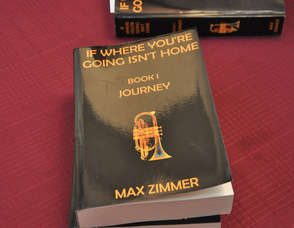 Copies of Max Zimmer's books, ready to be autographed.