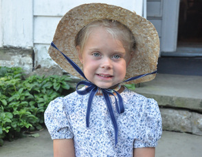 Baylie Touw, age 4, member of Children of the American Revolution (CAR) in period-style costume.