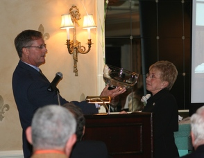 Charles Weidman presenting Linda Maggio with a gift on behalf of the WUF
