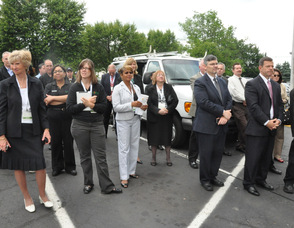 Employees listen to Spires at the grand reopening.