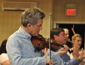 Georgian Banov plays the violin along with Living Waters Fellowship's Worship Team.
