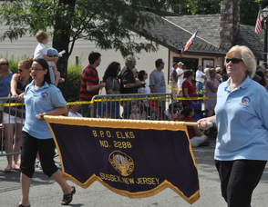 Members of the Sussex Elks march by.