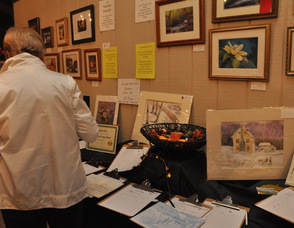 Attendees browse through the silent auction items.