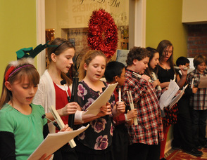 Carolers sing at The Springboard Shoppes.