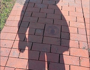 Self-portrait shadow photograph of Joel Aronson while saluting US Military symbols at the Memorial Park in Wharton, NJ. The photo was taken Veterans Day 2011, 11/11/11 at 11:11 AM. Joel is a veteran of the US AIr Force.