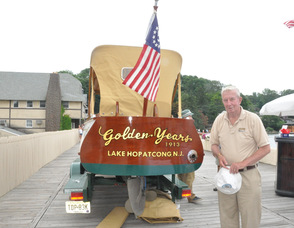 "Sam Hoagland with his boat, ""Golden Years""."