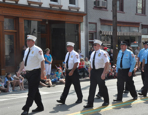 The Newton Fire Department marches down Spring Street.