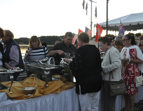 Guest help themselves to food on the Boardwalk.
