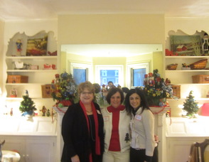 Patti Larkins, the social events chair, Anne Lawless, president of the club and Deanna Peterson, the hostess
