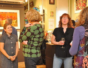 Jennie Traill Schaffer, owner of TraillWorks, mingles with exhibit attendees.