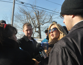 Members of the media interview Betty Marcus.