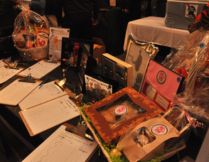 Items at the silent auction including picture frames, and gift baskets.
