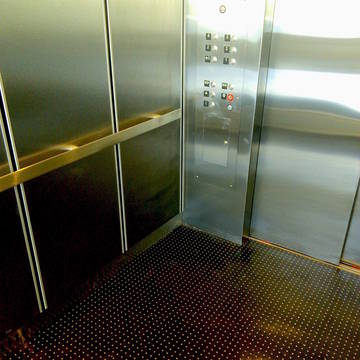 Top_story_271d4ce6c7c3ed2da2c7_c916656a64ea4ffa207e_tier_garage_elevator_finished