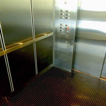 Top_story_271d4ce6c7c3ed2da2c7_c916656a64ea4ffa207e_tier_garage_elevator_finished