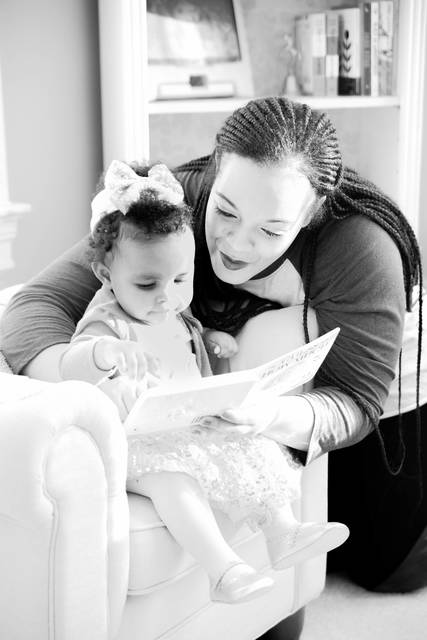 Top_story_69e7b5757dd864ad09df_mom_reading_to_ella_bw