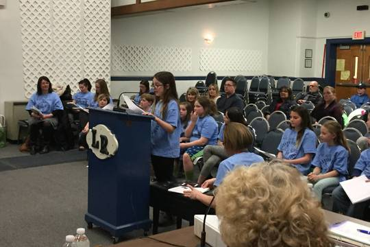 Top_story_9f6cc889cb6886c90ab2_f1739d1570918ac774aa_katie_dougherty_presenting_at_board_meeting