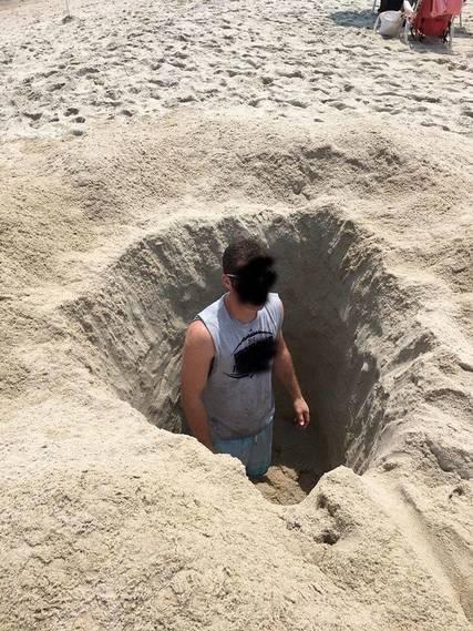 Top_story_b3835c9214b3293cd05b_beach_hole_digging_warning