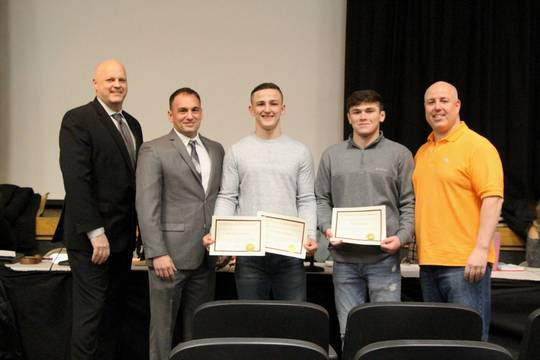 Top_story_b3e370c137eb6f2ed1dc_edit_wrestlers_honored_at_boe