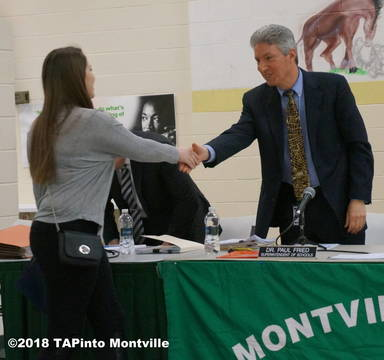 Top_story_d29f2631026eb0733e2e_former_superintendent_of_schools_paul_fried_congratulates_a_student_in_2015__2018_tapinto_montville