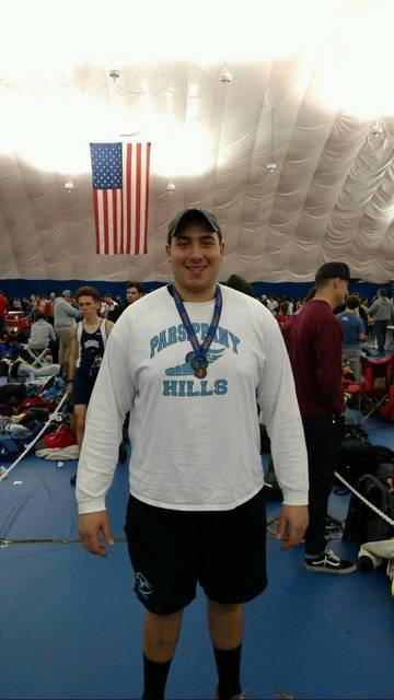 Top_story_dcfd8903822d091e0f3d_justin_gurth_displays_the_medal_he_won_for_finising_third_at_the_group_4_indoor_meet