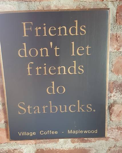 Top_story_f1471740215dcd540160_starbucks_sign_village_coffee
